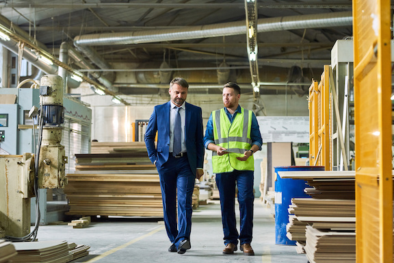 Mature Businessman Inspecting Modern Factory